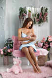 Mother breastfeeding her newborn child stock photography