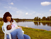 Mother breastfeeding Royalty Free Stock Images