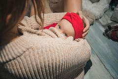 Soft photo of young mother feeding baby at home stock image