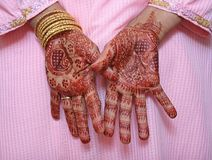 Mother of the Bride. Mehndi artists decorated hands of the brides mother with Henna designs stock photos