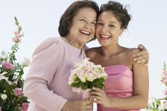 Mother and Bride with bouquet outdoors (portrait) Royalty Free Stock Image