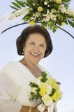Mother of bride with bouquet outdoors (portrait) Stock Photo
