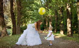 Mother bride  and daughter in the park Royalty Free Stock Photography