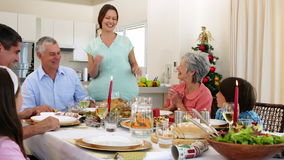 Mother bringing turkey to dinner table for christmas Stock Photography