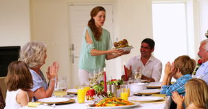 Mother bringing turkey to dinner table at christmas Royalty Free Stock Photo