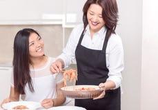 Mother bringing up fresh dish Royalty Free Stock Photo