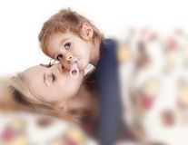 Mother brings her child to bed Stock Image