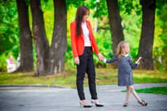 Mother brings her daughter to school. Adorable little girl feeling very excited about going back to school Stock Photography