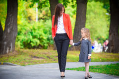 Mother brings her daughter to school. Adorable little girl feeling very excited about going back to school Royalty Free Stock Photos