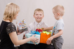 Mother and brother give teen gifts Royalty Free Stock Photography