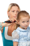 Mother brushes hair of the daughter Royalty Free Stock Image