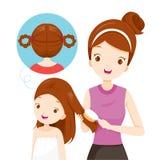 Mother Brushing Daughter Hair Royalty Free Stock Photo