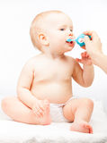 Mother brushing teeth of her little baby Royalty Free Stock Photo