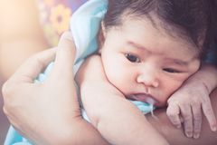 Mother burping her newborn baby girl after meal Stock Images