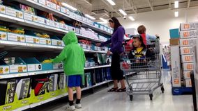 Mother buying some office supplies for her children back to school stuff Stock Photo