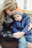 Mother calming down  son Stock Images