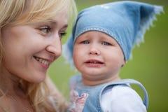 Mother calms her crying daughter Stock Photos