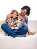 Mother care daughter using earphone on smartphone Stock Photo