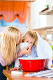 Mother care for sick child with vapor-bath. At domestic kitchen Royalty Free Stock Photography