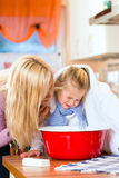 Mother care for sick child with vapor-bath. At domestic kitchen Stock Photo