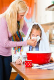 Mother care for sick child with vapor-bath. At domestic kitchen Royalty Free Stock Photo