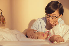 Mother care sick kid stock photography