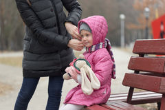 Mother cares for her daughter in the open air Stock Photos