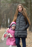 Mother cares for her daughter in the open air Royalty Free Stock Photo