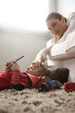 Mother caressing son's forehead Stock Images
