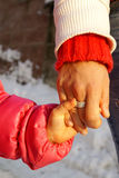 Mother caring child, hands. Parent guiding child hand in hand. Holding hands together. Concept of trust and help Royalty Free Stock Image