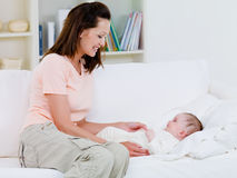 Mother caring about her baby Stock Images