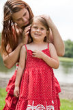 Mother is caring her daugther Royalty Free Stock Images