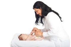 Mother caring newborn baby. Boy isolated on white background Stock Image