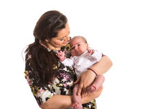 Mother caring newborn baby girl Stock Image