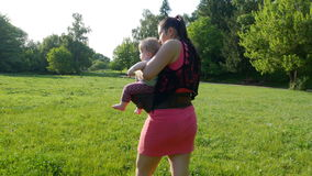 Mother carries her baby stock footage