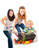 Mother carries her children in a shopping cart royalty free stock photos