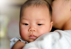 Mother carry the baby in arm royalty free stock image