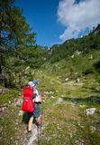 Mother carrying baby in alps Royalty Free Stock Images