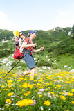 Mother carrying baby in alps Stock Photo