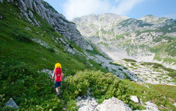 Mother carrying baby in alps Royalty Free Stock Image