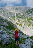 Mother carrying baby in alps Royalty Free Stock Photography