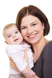 Mother carrying baby girl Royalty Free Stock Image