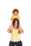 Mother carrying boy on her shoulders Stock Image