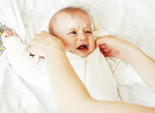 Mother carrying clothers for baby todler little son crying, unha Stock Photo