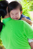 Mother carrying and comfort her daughter Royalty Free Stock Image