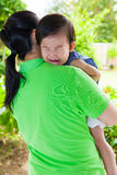 Mother carrying and comfort her daughter Stock Photography