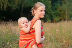 Mother carrying daughter Royalty Free Stock Photo