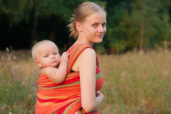 Mother carrying daughter  Royalty Free Stock Photography