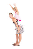 Mother carrying daughter Royalty Free Stock Image