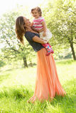 Mother Carrying Daughter In  Summer Field Royalty Free Stock Images